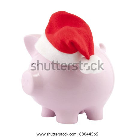 Piggy bank with Santa Claus hat. Clipping path included.