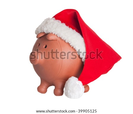 Piggy bank with Santa Claus hat isolated on white