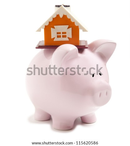 Piggy bank with small model house isolated