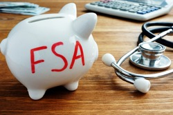 Piggy bank with words Flexible Spending Account FSA.