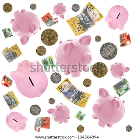 Piggy banks and Australian money falling over white background.