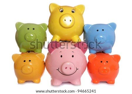 Piggy banks stacked on a white background