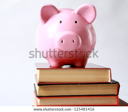 piggy box and book in isolated white background
