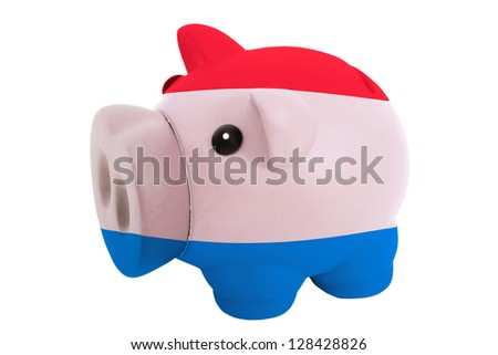 piggy rich bank in colors national flag of netherlands for savings on white background