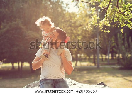 Piggyback of baby and dad