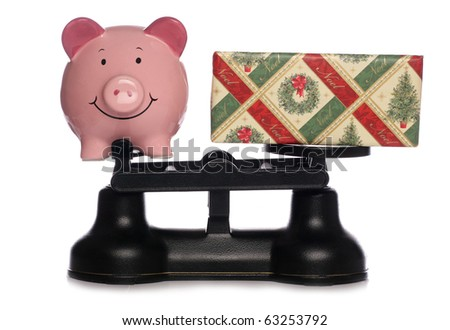 Piggybank and christmas present on scales studio cutout