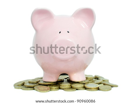 Piggybank on a pile of coins