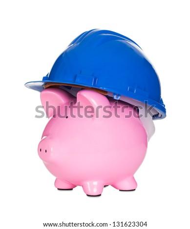 Piggybank wearing construction helmet. Isolated on white