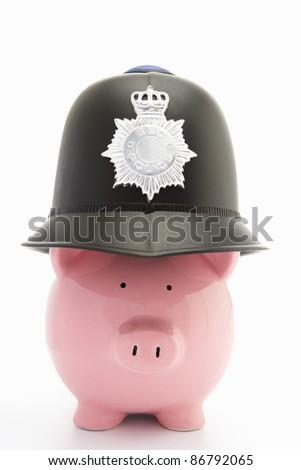 Piggybank with policeman's helmet