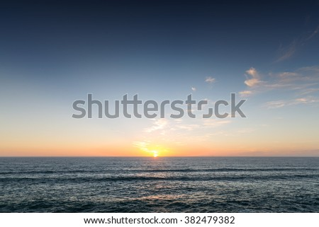 Piha Beach at Sunset, overviewing the ocean, Auckland, New Zealand #382479382