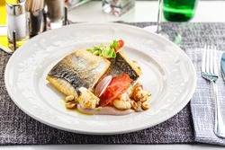 Pike perch fillet with chorizo, cauliflower and radish in a restaurant serving
