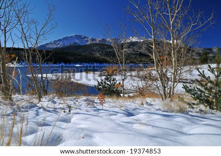 Pikes Peak at Crystal Reservoir near Colorado Springs, Colorado after an October white fluffy snowfall with Aspen Trees
