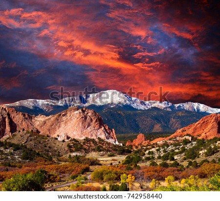 Pikes Peak Soaring over the Garden of the Gods with Dramatic Sky #742958440