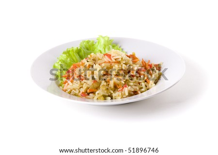 pilaf on plate decorated with leaf on white ground