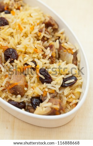 Pilaf with beef, carrots, spices, and dried fruits