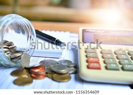 pile coins on paper bill for concept cost investment and debt Stock photo ©