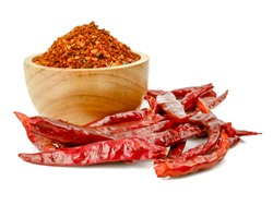 Pile crushed red pepper, Cayenne pepper, dried chili flakes isolated on white background
