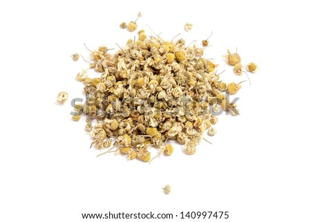 Pile dried chamomile tea isolated on white background