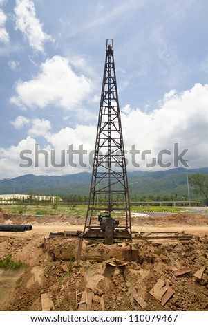Pile driver in a construction site - stock photo