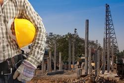Pile driver  works to set precast concrete piles in a construction area