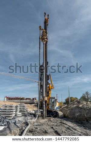 Pile driving drilling machine working on road construction. Road building with drilling machine. Drilling machine ready to drill piles on a road building site
