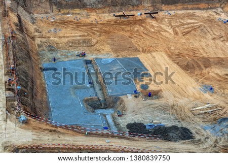 Pile driving in foundation pit for construction of apartment building. Piling driven into ground. Deep foundation installation. Reinforce prestressed concrete piles for factory foundation construction #1380839750