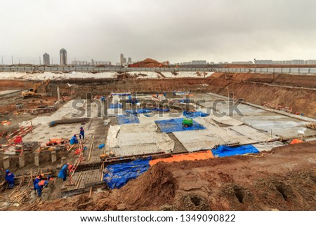 Pile driving of hydraulic drilling machines on construction site. Construction equipment for piling into ground. Hydraulic drilling machine is boring holes for bored piles. Concrete