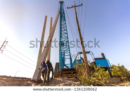 Pile driving working at construction site. Hydraulic drilling machines for piling into ground.