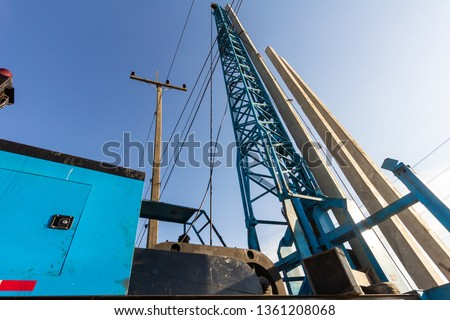 Pile driving working at construction site. Hydraulic drilling machines for piling into ground. #1361208068