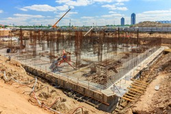 Pile field processing at mark. Panorama of pit. deep foundation is type of foundation that transfers building loads to earth farther down from surface than shallow foundation. subsurface layer