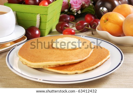 Pile fresh pancake with butter