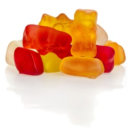 Pile gummy bear candies isolated on white