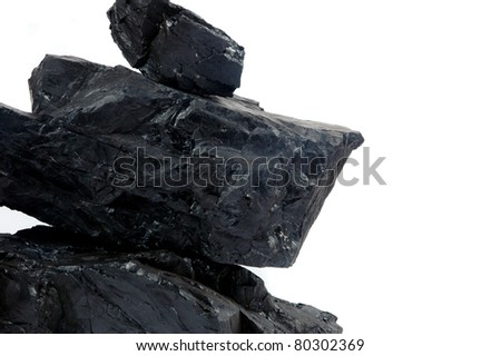 pile lumps of coals isoated on white background