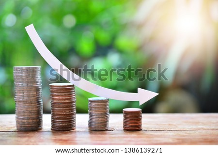 pile money coins saving trend decrease for investment mutual fund finance and business Сток-фото ©