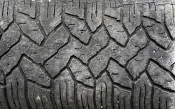 pile of a worn out car tires pattern background
