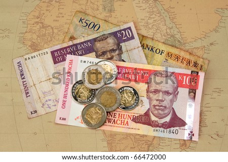 Pile of African currency on map