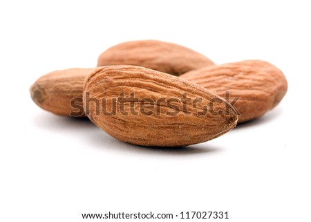 pile of almonds on white
