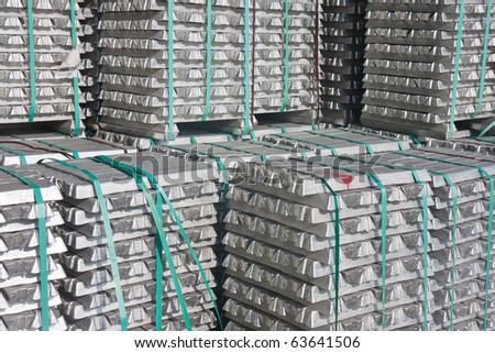 Pile of aluminium bricks waiting for transport to the factory - stock photo