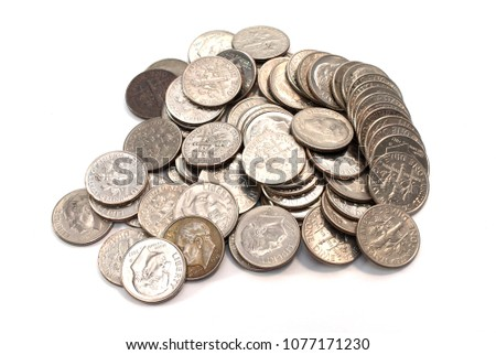 Pile of American coins (dime) on a white background.