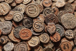 Pile of ancient Byzantine copper coins top view, macro