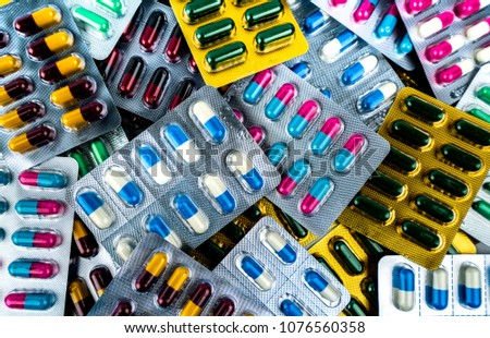 Pile of antibiotic capsule pills in blister packs. Medicine for infection disease. Antibiotic drug use with reasonable. Drug resistance, healthcare concept. Pharmaceutical industry.
