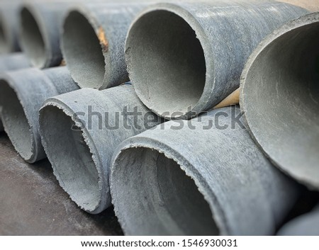 Pile of asbestos cement pipes, drainage pipes, asbestos pipes.