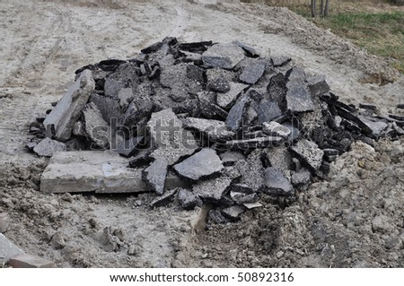 Pile of asphalt rubble - stock photo
