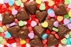 Pile of assorted chocolate and sugar heart shaped Valentine's Day candy