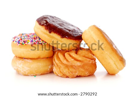 Pile of assorted donuts isolated on white background - stock photo