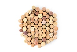 Pile of assorted used wine corks in shape of circle isolated on white background. Close up top view.