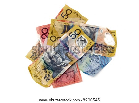 pile of Australian money on a white background