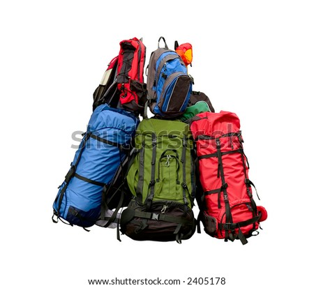 Pile of backpacks - backpacking concept isolated on white with clipping path