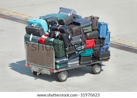 Pile of bags on a cart at an airport