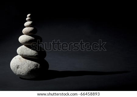 Pile of balanced stones with dark shadows